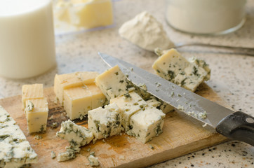 Blue cheese cutted on wooden plate