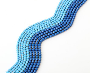 Blue bracelet on a white background
