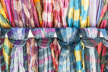 Knotted colorful cotton scarves on display