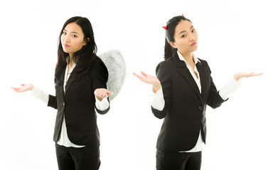 Angel side and devil side of a young Asian businesswoman