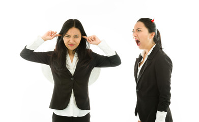 Devil side of a young Asian businesswoman shouting over angel