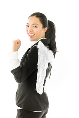 Asian young businesswoman dressed up as white angel looking