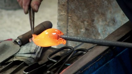 Craftsman makes glass animals in the glass blower workshop