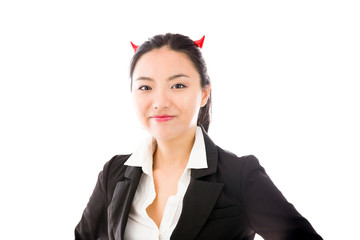 Devil side of a young Asian businesswoman smiling isolated on