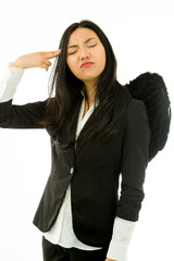 Asian young businesswoman dressed up as black angel pointing
