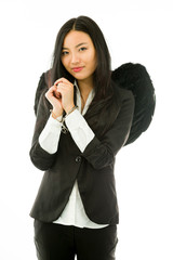 Asian young businesswoman dressed up as black angel handcuffs