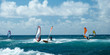 Leinwandbild Motiv Windsurfers in windy weather on Maui Island panorama