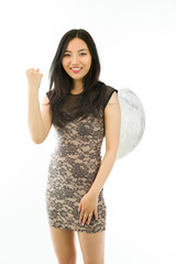 Asian young woman dressed up as an angel celebrating her success