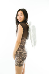 Asian young woman dressed up as an angel smiling with isolated