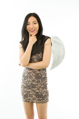Asian young woman dressed up as an angel smiling isolated on