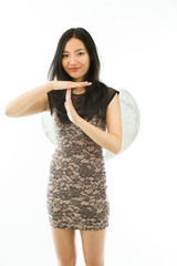 Asian young woman dressed up as an angel making time out signal