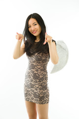Asian young woman dressed up as an angel pointing towards camera