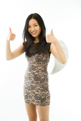 Asian young woman dressed up as an angel with showing thumb up