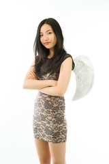 Asian young woman dressed up as an angel standing with her arms