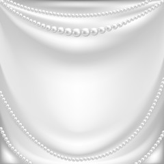 silk drapery and pearl necklace