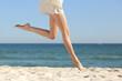 Beautiful woman long legs jumping on the beach