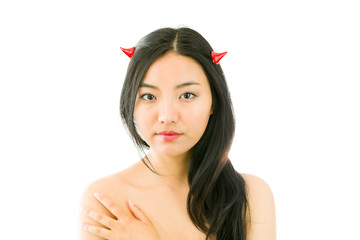 Devil side of a young naked Asian woman touching her shoulder