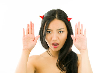 Devil side of a young naked Asian woman making stop gesture sign
