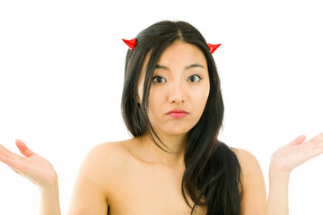 Devil side of a young naked Asian woman gesturing and looking
