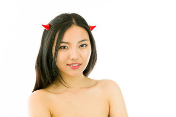 Devil side of a young naked Asian woman smiling