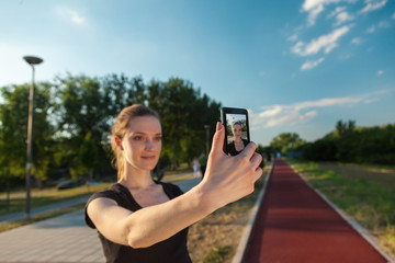 Female Runner Taking Selfie