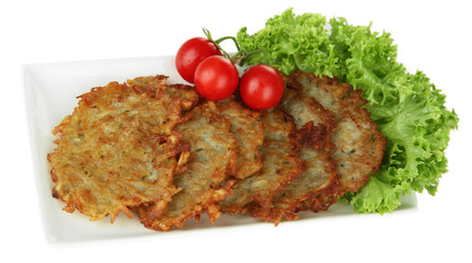Potato pancakes on plate, isolated on white