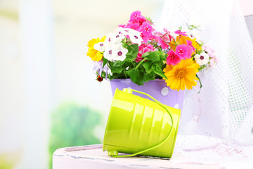 Bouquet of colorful flowers in decorative bucket,