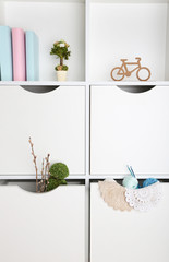 Beautiful white drawers and shelves with different home related