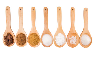 Various type of sugar on wooden spoon over white background