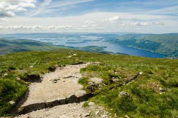 Path leading to the top of Ben Lomond in a sunny  day.