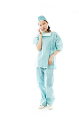 Asian female surgeon talking on the mobile phone looking worried