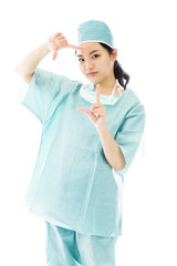 Asian female surgeon looking through finger frame