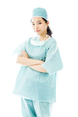 Confident Asian female surgeon standing with arms crossed