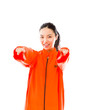 Young Asian woman pointing towards camera with both hands in