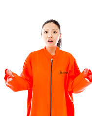 Young Asian woman shrugging in prisoners uniform
