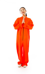 Young Asian woman standing in prayer position in prisoners