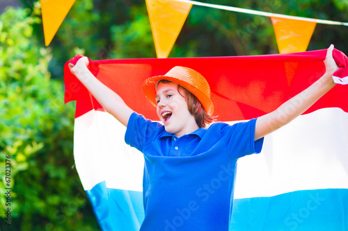 canvas print picture Dutch football fan, little boy cheering