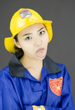 Close up of a tired lady firefighter poking out tongue poster