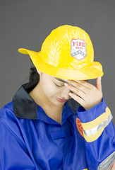 Close up of a lady firefighter suffering from headache