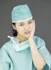 Asian female surgeon looking bored