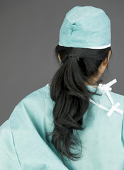 Rear view of an Asian female surgeon