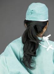 Rear view of an Asian female surgeon