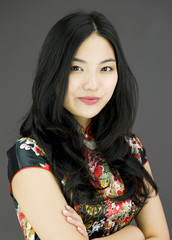 Confident Asian young woman with arms crossed