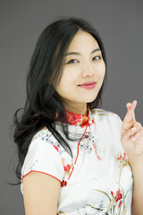 Asian young woman crossing her fingers