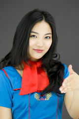 Asian air stewardess giving hand for handshake