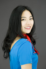 Asian young woman turning back isolated on colored background