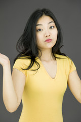 Young Asian woman shrugging