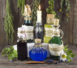 Glass bottles with healing remedies and candle