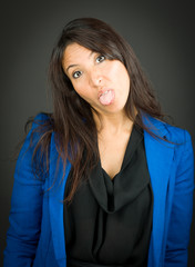 Portrait of a young businesswoman sticking out her tongue