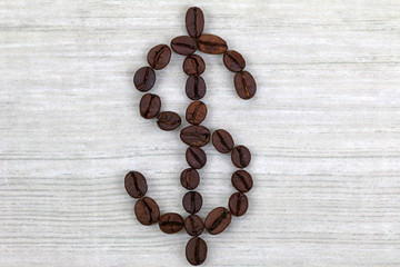 Coffee beans in a shape of Dollar sign